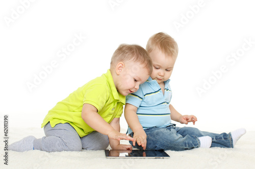 Small children with computer tablet..