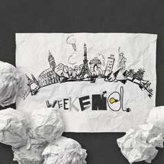 crumpled paper and traveling around the world with word weekend