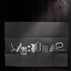 design word WEBINAR on dark crumpled paper and texture backgroun