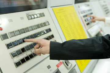 businessman purchasing ticket at station
