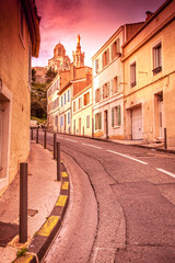 view of Notre Dame de la Garde in the evening at sunset. The Fre