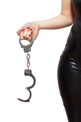 Dominatrix holding handcuffs