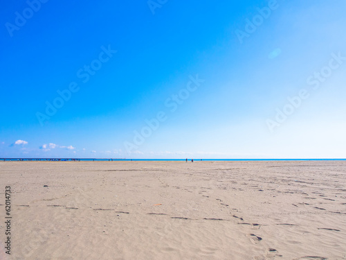 Shining blue sky, sea and sand beach