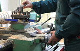 Man works in a lathe