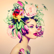Spring Woman. Beauty Girl with Flowers Hair Style