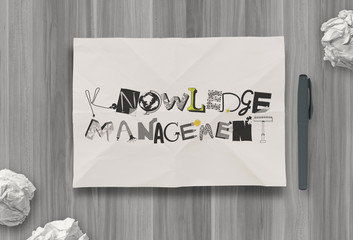 design word KNOWLEDGE MANAGEMENTon crumpled paper as concept