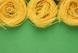 Tagliatelle pasta background on the green background