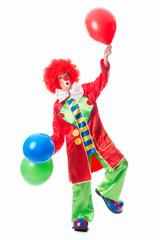 Erstaunter Clown mit Luftballons
