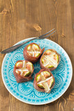 Figs wrapped in ham on blue plate