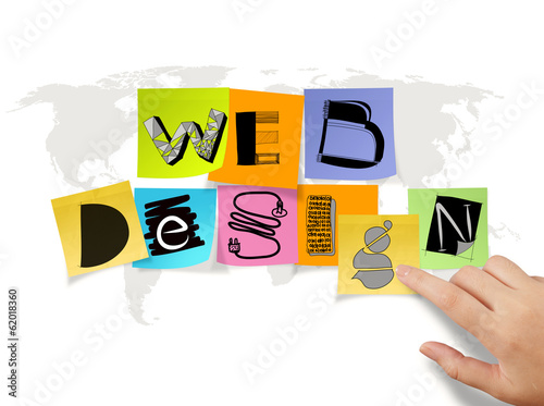 hand touch drawing web design on sticky note and world map backg
