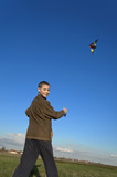 Boy flying a kite face far slant