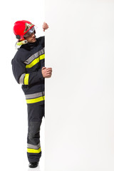 Fireman holding big blank banner