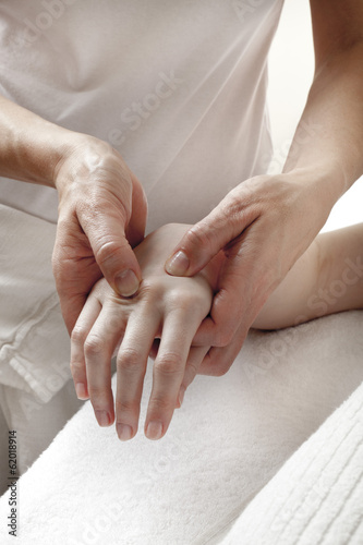 physical therapist massaging hands