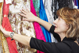 Mature  woman choosing clothes