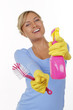 Happy house wife with cleaning gear