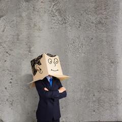Businessman with box on head