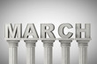 March month sign on a classic columns