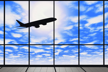 Airport windows with flying airplane