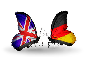 Two butterflies with flags UK and Germany