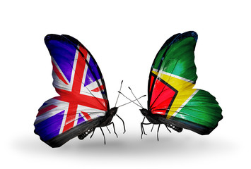 Two butterflies with flags UK and Guyana