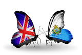 Two butterflies with flags UK and San Marino