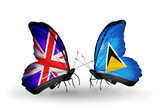 Two butterflies with flags  UK and Saint Lucia
