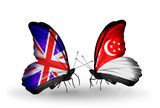 Two butterflies with flags  UK and Singapore