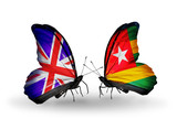 Two butterflies with flags UK and Togo
