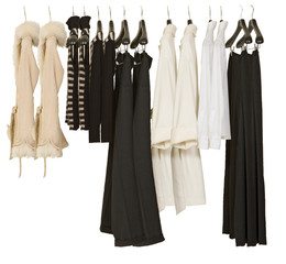 female clothes on cropped hangers. White background.
