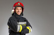 Leinwanddruck Bild - Cheerful firefighter with crossed arms.