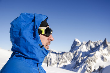 Alpinist looking at mountains