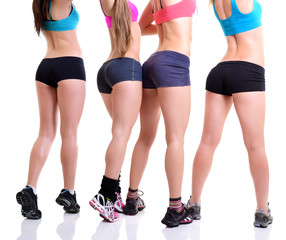 legs and bottoms of fitness girls, back view of sport young wome