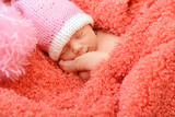 sleeping cute baby funny pink hat in soft fabric, beautiful kid'