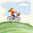 young girl cycling in the meadow