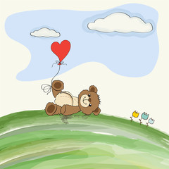 cute doodle teddy bear with heart on meadow