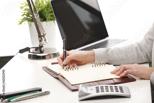 Close-up of a businesswoman analyzing