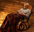 Senior man fell asleep on rocking chair
