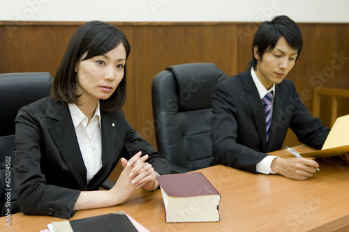 lawyer with serious look - 62024502
