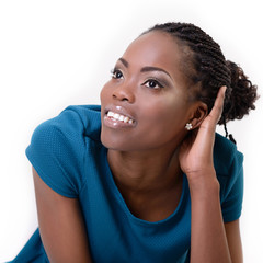 Beautiful young african woman dreaming and looking left into the
