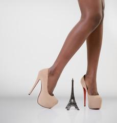 Parisian - beautiful long legs african model standing on high he