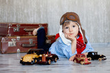 Little boy, playing with wooden cars