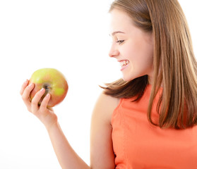 Attractive teen girl holding an apple in her hand and happy smil