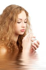 Woman with moisturizing cream
