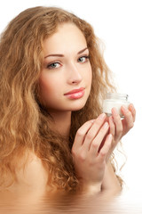 Woman with moisturizing cream