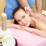 Beautiful woman enjoy having relaxing massage her back in spa sa