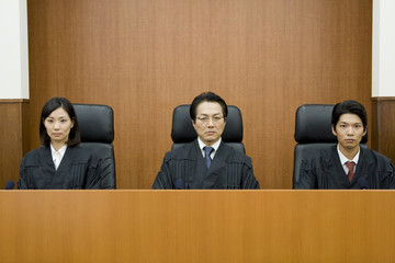 judge sitting on chair