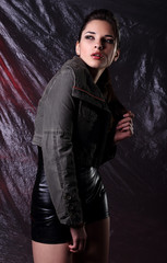 Woman in  leather black  costume