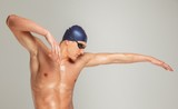 Young athletic man in swimming cap and googles