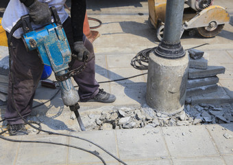 worker of road construction drilling cement ground  use for infr