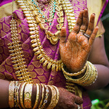 Hands of an Indian bride adorned with jewelery